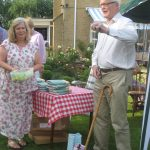 The raffle is drawn by Lord Hurd from a container of tickets held by a WTN committee member.