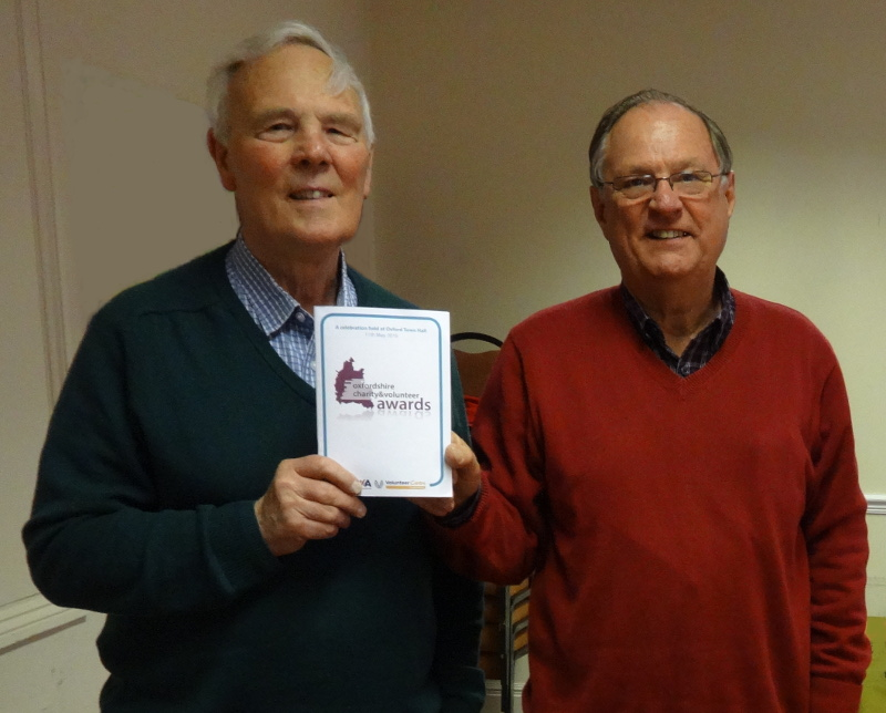 Secretary, Peter Bee, and Chairman, Peter Brading, hold a copy of the OCVA Awards Programme.