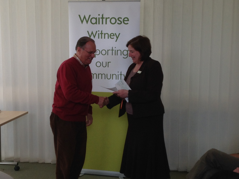 WTN Chairman, Peter Brading, receives a cheque from Waitrose Witney after WTN was chosen to be a Waitrose Community Matters beneficiary.