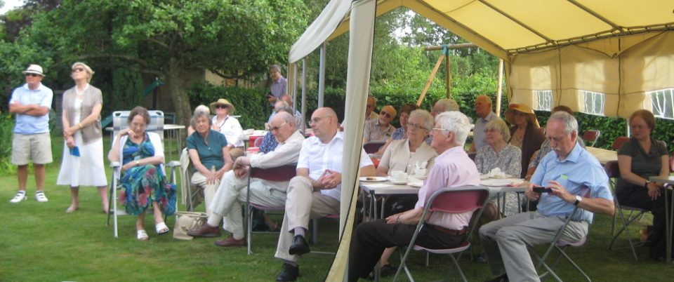 Listeners and volunteers enjoy tea and cakes in the marquee.