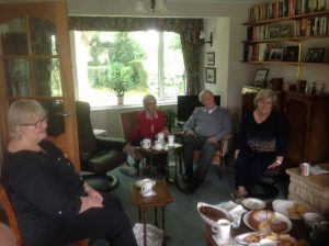 Members of the WTN committee share coffee and cake with long-term volunteer Jane Holmes as she leaves Witney and WTN.