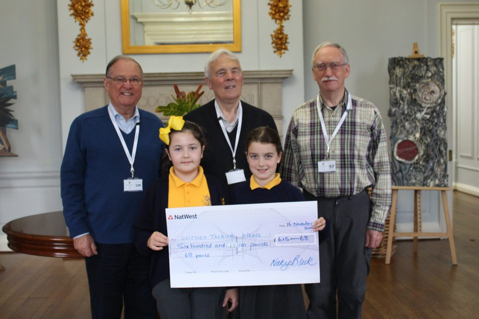 WTN Chairman Peter Brading, Secretary Peter Bee and outside broadcast engineer Eric Imeson receive a cheque from pupils at Cokethorpe School.